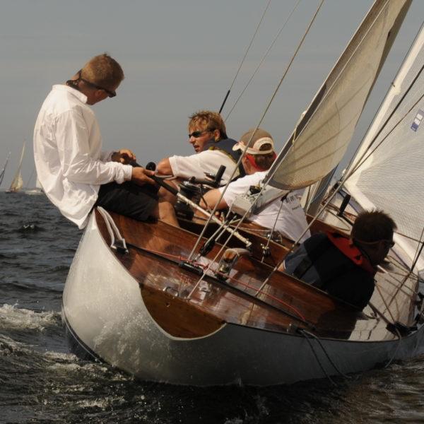 Sailing boat underway. Close up of crew.