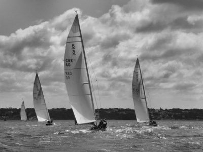 Black and white photo of boats racing