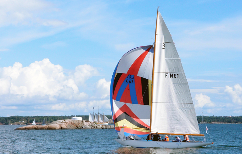 Sailing boat underway with colourful spinnaker sail