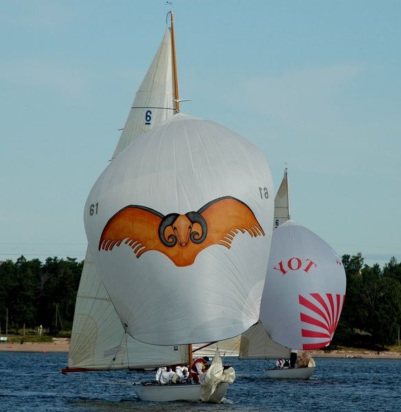 Two sailing boats underway with spinnaker sails raised