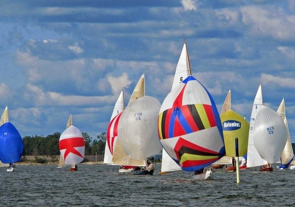 Sailing boats racing with colourful spinnaker sails raised