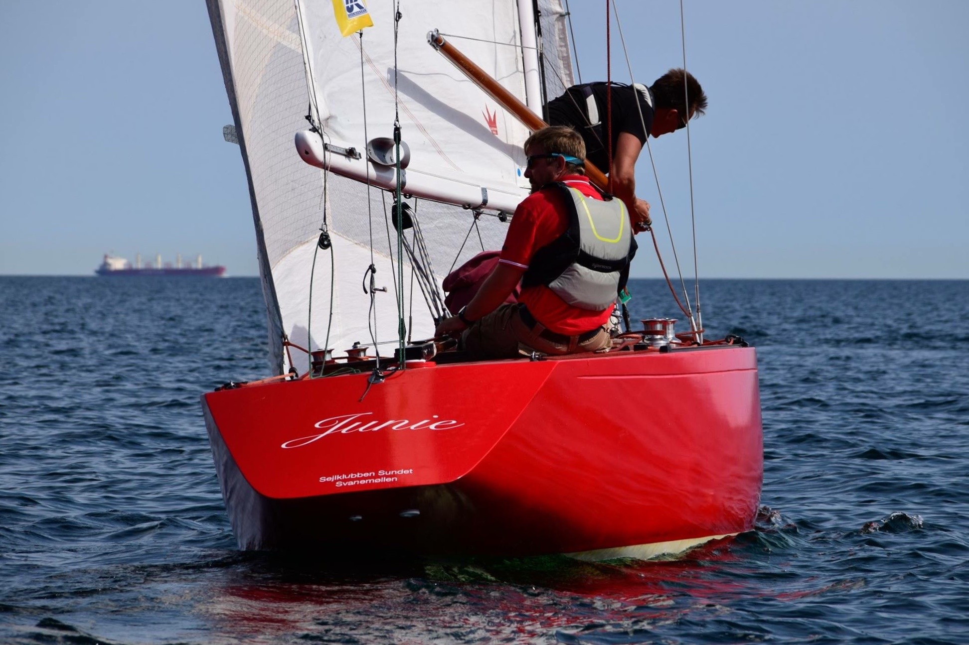 Close up picture of a red sailing boat