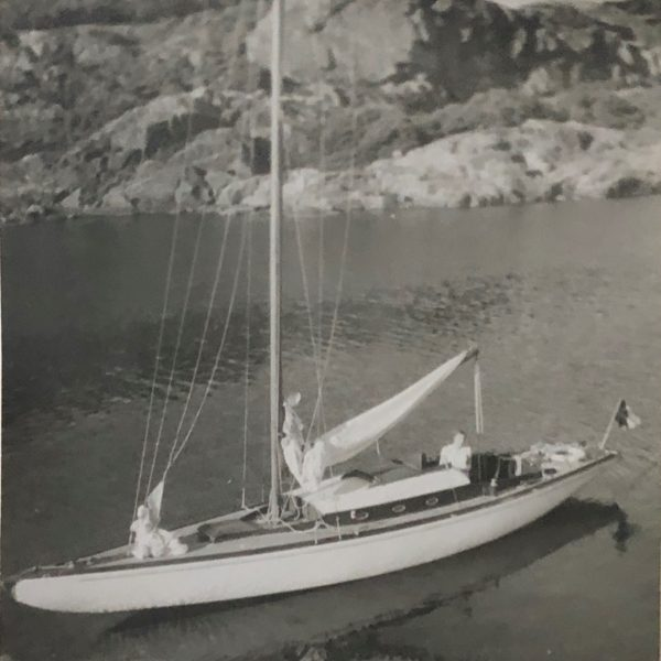 Blck and white photograph of sailing boat at anchor