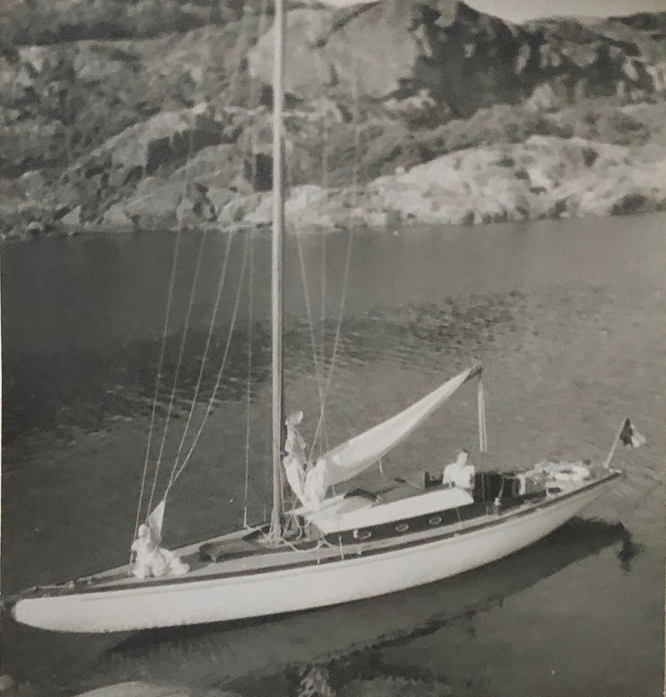 Blck and white photograph of sailing boat at anchor