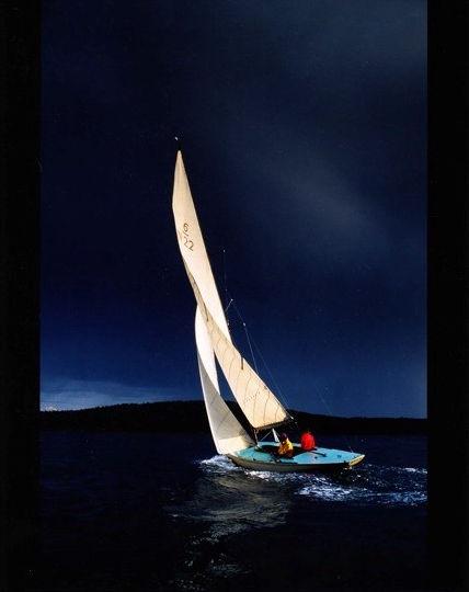 sailing boat and a dark sky