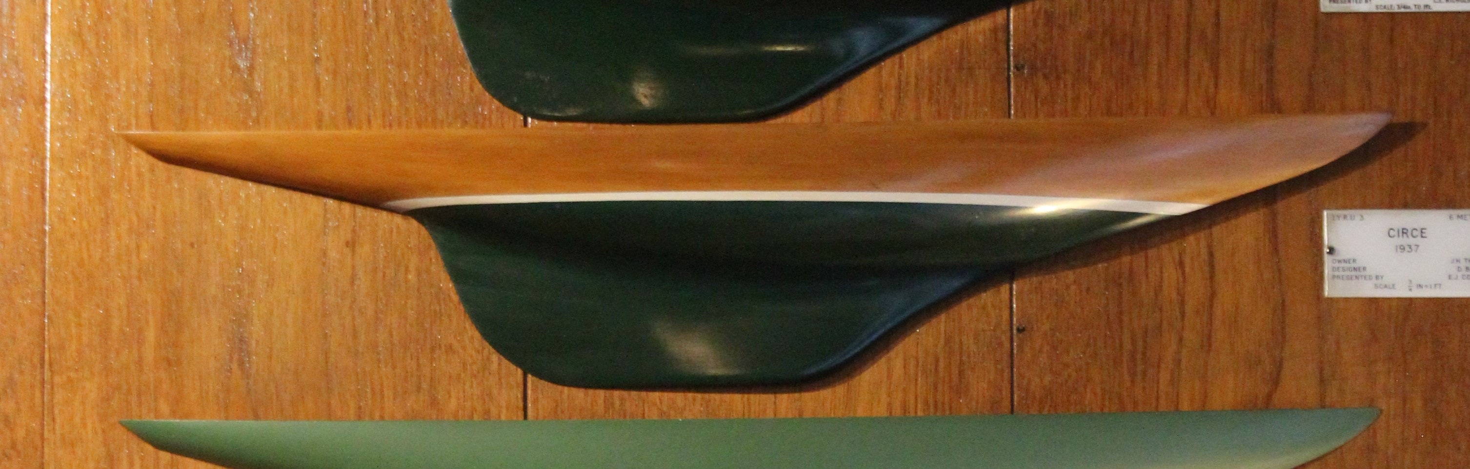 Boat model mounted on a wooden wall